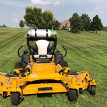 yellow lawnmover on hillside yard