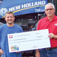 Two men holding a paper check