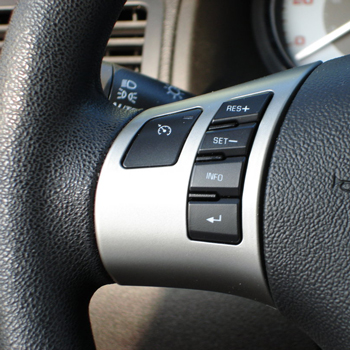 Close up of steering wheel's cruise control buttons