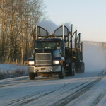 Logging truck driving in snow, driving, snow, winter, road, truck, transportation, diesel gelling,