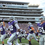 Kansas State Wildcat team running out onto the Bill Snyder Family Stadium.