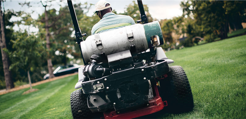 propane-landscaping, propane landscaping, people, one person, equipment, landscaping, mowing, mowing with propane, propane-powered mower,