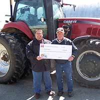 Ron Olson, Comstock, Wis, people, Cenex, Check, employee, ag equipment, tractor,